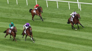 St Mark's Basilica (second left) drifts across the track in front of Tarnawa before winning the Irish Champion Stakes at Leopardstown. Poetic Flare (right) ran well to finish third on his first try at 1m2f