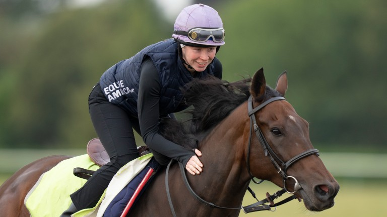 Rosie Margarson and Caribbean Spring (Bean) enjoy a routine exercise up Long Hill in Newmarket