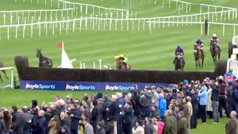A riderless Al Boum Photo gallops away as The Storyteller takes the last fence on his own