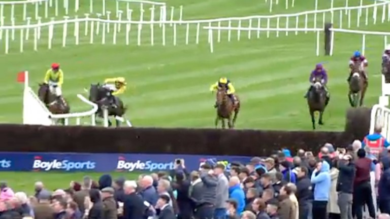 Al Boum Photo crashes through the rail and unseats Townend, with The Storyteller clear