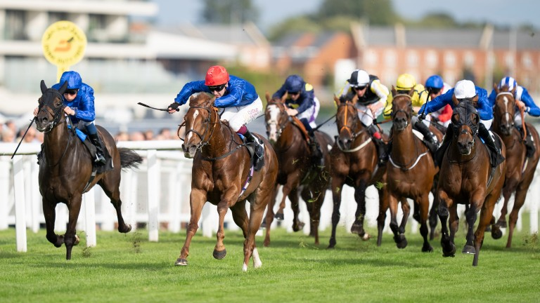Silent Escape (red cap) and Oisin Murphy power away from D'Bai (white cap) and the William Buick-ridden Al Suhail (blue cap) for a Godolphin 1-2-3