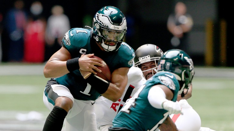 Jalen Hurts protects the ball for the Philadelphia Eagles