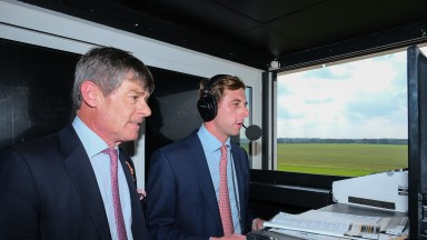 Simon and Ed Crisford prepare to call the second race at Newmarket