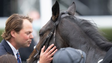Trainer Charlie Fellowes celebrates his first Group winner in the UK by kissing Eve Lodge after the Sirenia Stakes Kempton 4.9.21 Pic: Edward Whitaker