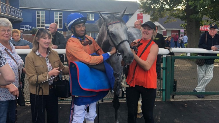 Kaiya Fraser, groom Natalie Holmes and connections pose for a photo after the apprentice rides his first winner aboard Hi Ho Silver at Leicester on Monday