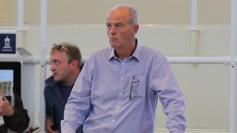 Eddie Lynam tracks a yearling's price on the bid board