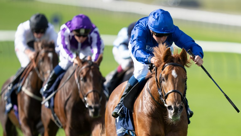 Modern Games pricks his ears in the final stages of the Tattersalls Stakes at Newmarket, with favourite Trident (purple) in arrears