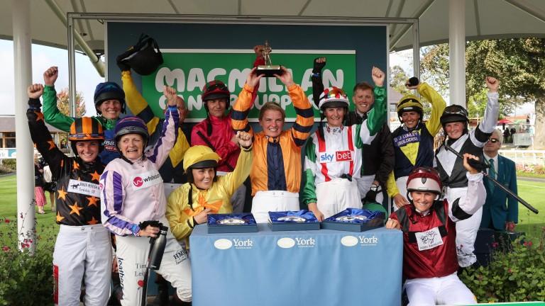 Luci Hughes (orange silks) wins the Macmillan Ride of Their Lives Charity Race