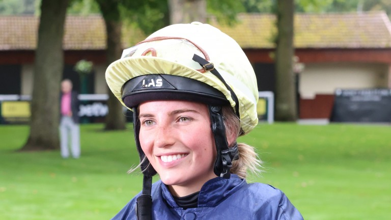 Hannah Fraser is all smiles after gaining her first victory in the saddle