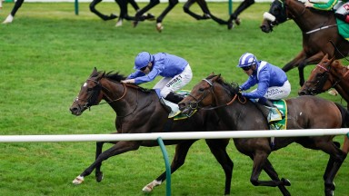 NEWMARKET, ENGLAND - SEPTEMBER 25: Jamie Spencer riding Bedouin's Story (L, blue) win The bet365 Cambridgeshire Handicap at Newmarket Racecourse on September 25, 2021 in Newmarket, England. (Photo by Alan Crowhurst/Getty Images)