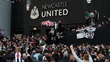 Newcastle fans celebrate news of their takeover