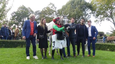 Le Berry with jockey Kevin Nabet and trainer David Cottin (third from the right) after winning the Prix Heros XII at Auteuil