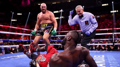 Tyson Fury floors Deontay Wilder in their trilogy fight