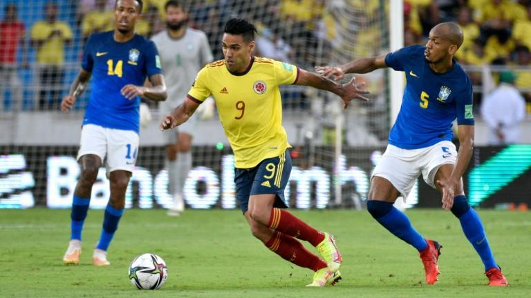 Veteran Colombia striker Radamel Falcao (centre) tussles with Brazil's Fabinho