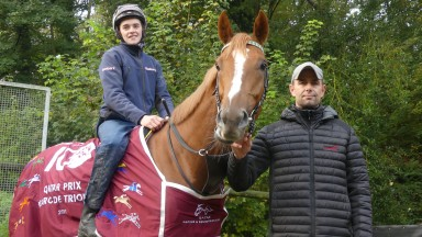 Sean Byrne and Qatar Prix de l'Arc winner Torquator Tasso with trainer Marcel Weiss