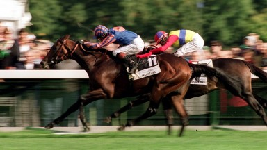 Making light of the mud: Montjeu (near side) gets the better of El Condor Pasa to win the 1999 Arc on heavy ground