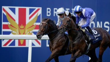 ASCOT, ENGLAND - OCTOBER 16: Jim Crowley riding Baaeed (blue/white) win The Queen Elizabeth II Stakes during the Qipco British Champions Day at Ascot Racecourse on October 16, 2021 in Ascot, England. (Photo by Alan Crowhurst/Getty Images)