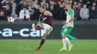 West Ham United's Craig Dawson and Rapid Vienna's Marco Grull in action