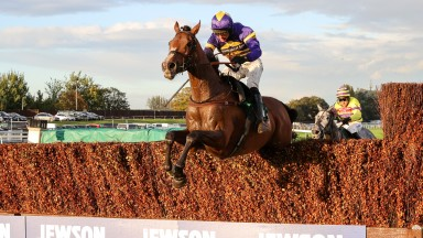 Corach Rambler soars over a fence en route to victory at Aintree